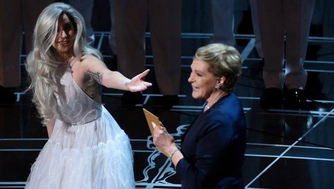 Lady Gaga greets Julie Andrews at 87th annual Academy Awards at the Dolby Theatre.