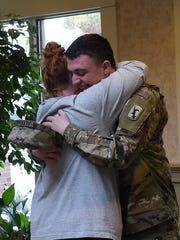 Army National Guard Pfc. Colton Alexander hugs his mother, Lawanda Alexander, as he surprises her on Friday morning at The Inn at Chapel Grove in Heath. Colton traveled from Nebraska, where he is stationed, to surprise his mother for Christmas.
