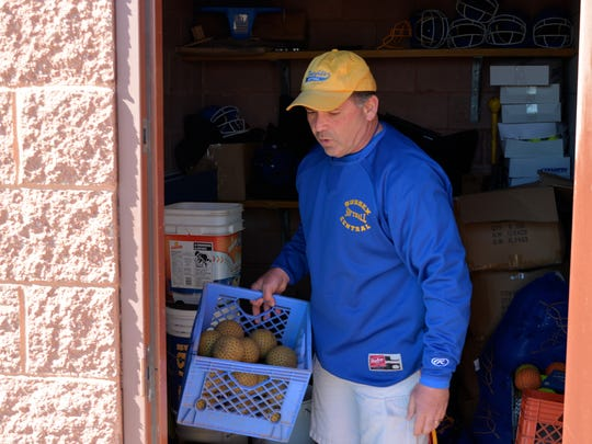 Sussex Central High School softball coach John Wells prepares for practice Monday, March 21.