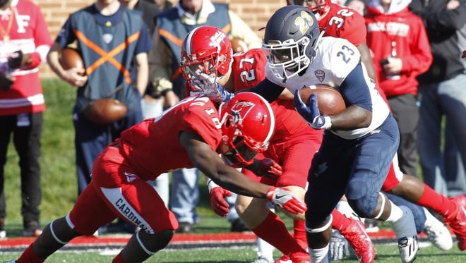 Akron running back Van Edwards rushes against Ball State on Saturday in Muncie, Indiana