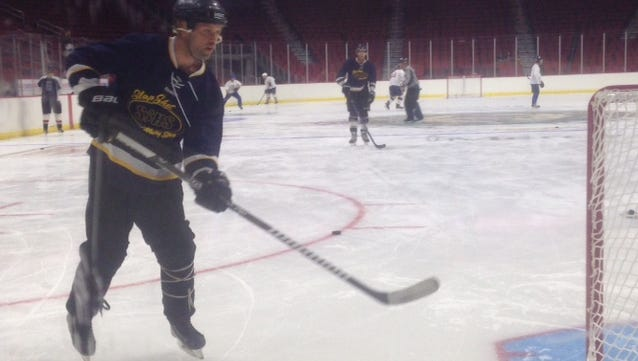 A player warms up before a charity game at Wells Fargo Arena. The game raised money for ALS research.