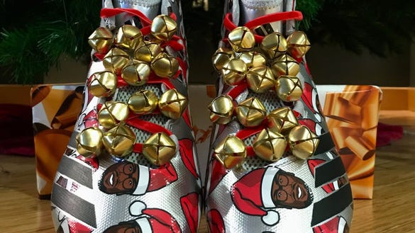 Von Miller's face is all over his amazing Adidas holiday cleats