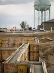 A solidifying concrete foundation for a housing development on 36th Avenue Northeast dries on Aug. 14. There continues to be rapid subdivision growth on the north end of Great Falls.