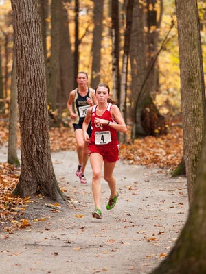 CVU's Sophia Gorman, in front, and Essex's AnnMarie Martell are two key runners in Saturday's Division I girls race at the high school cross-country state meet.