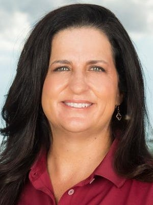 Auburn has hired Melissa Luellen, who led Arizona State to the 2009 NCAA title, to be women's golf coach.