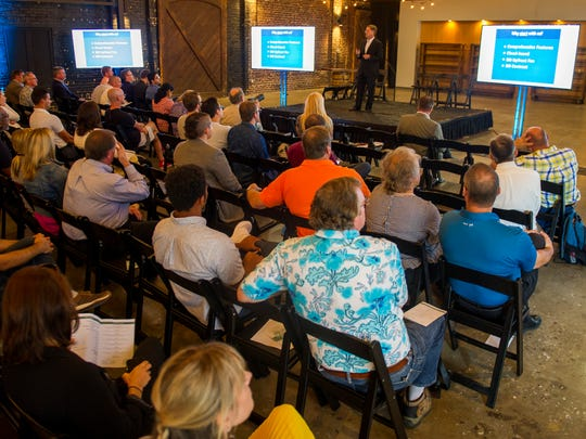 Guests listen as startup companies are presented during The Works: Demo Day 2017 at Jackson Terminal in Knoxville on Wednesday, Sept. 20, 2017.