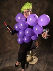 Sarah Coulter, PDN planning editor and part-time grape model, shows her refined side in preparation for Halloween on Oct. 21.