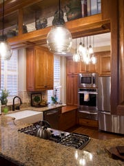 Bright pendant lights hang in the center of the kitchen