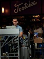 John Jenkins of Orlando enjoys Tootsies Orchid Lounge
