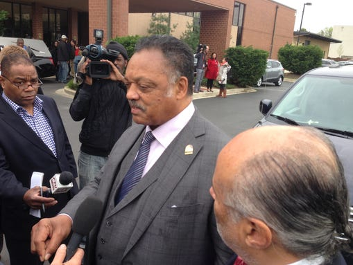 Jesse Jackson arrives at the funeral for Freddie Gray