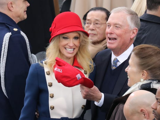 The Trump Campaign Manager, Kellyanne Conway and former Vice President Dan Quayle greet each other before the ceremony.