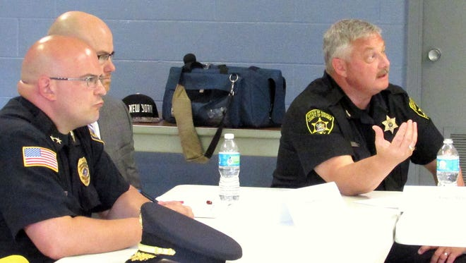 Steuben County Undersheriff Jim Allard, right, talks about problems his department faces with opioid abuse among jail inmates during a roundtable discussion Monday hosted by U.S. Rep. Tom Reed.
