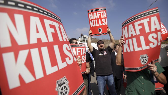 Teamsters union members hold signs opposing the North American Free Trade Agreement during a 2011 protest in San Diego.