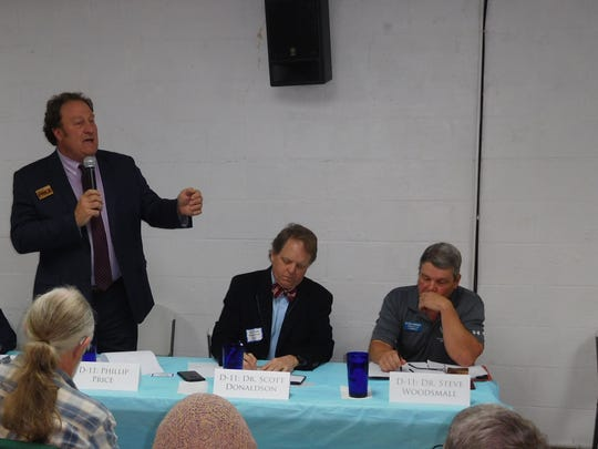 Congressional candidate Phillip Price speaks during a debate Monday.