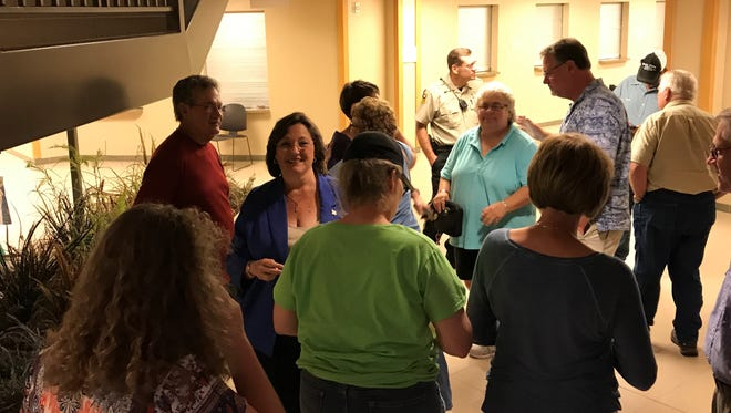Opponents of a proposed wind farm in Lincoln County celebrate after an election victory on Tuesday, July 18, 2017.