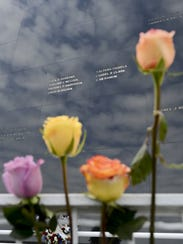 Friends and family of fallen astronauts place flowers