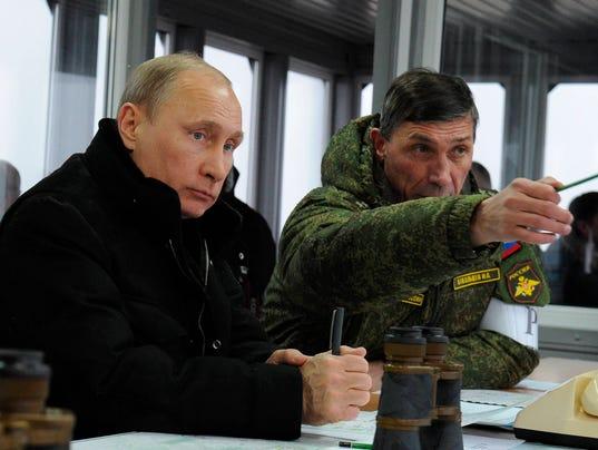 http://www.gannett-cdn.com/-mm-/fafd3ecdc1e51034178f5dca3d6e005e58652ffd/c=1856-528-4196-2290&r=x404&c=534x401/local/-/media/USATODAY/GenericImages/2014/03/04//1393935091000-AP-Russia-Putin.jpg