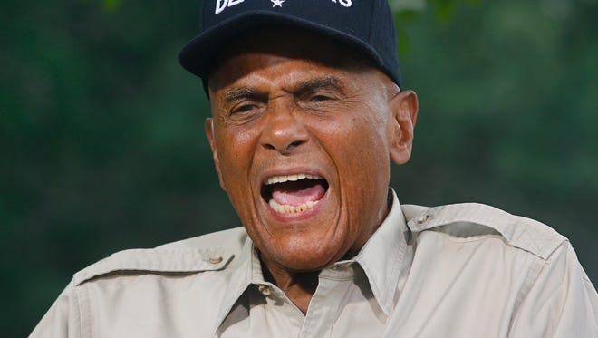 American singer, songwriter, actor and social activist Harry Belafonte, Jr. conducts a network interview outside the Florida Capitol in Tallahassee, Fla.