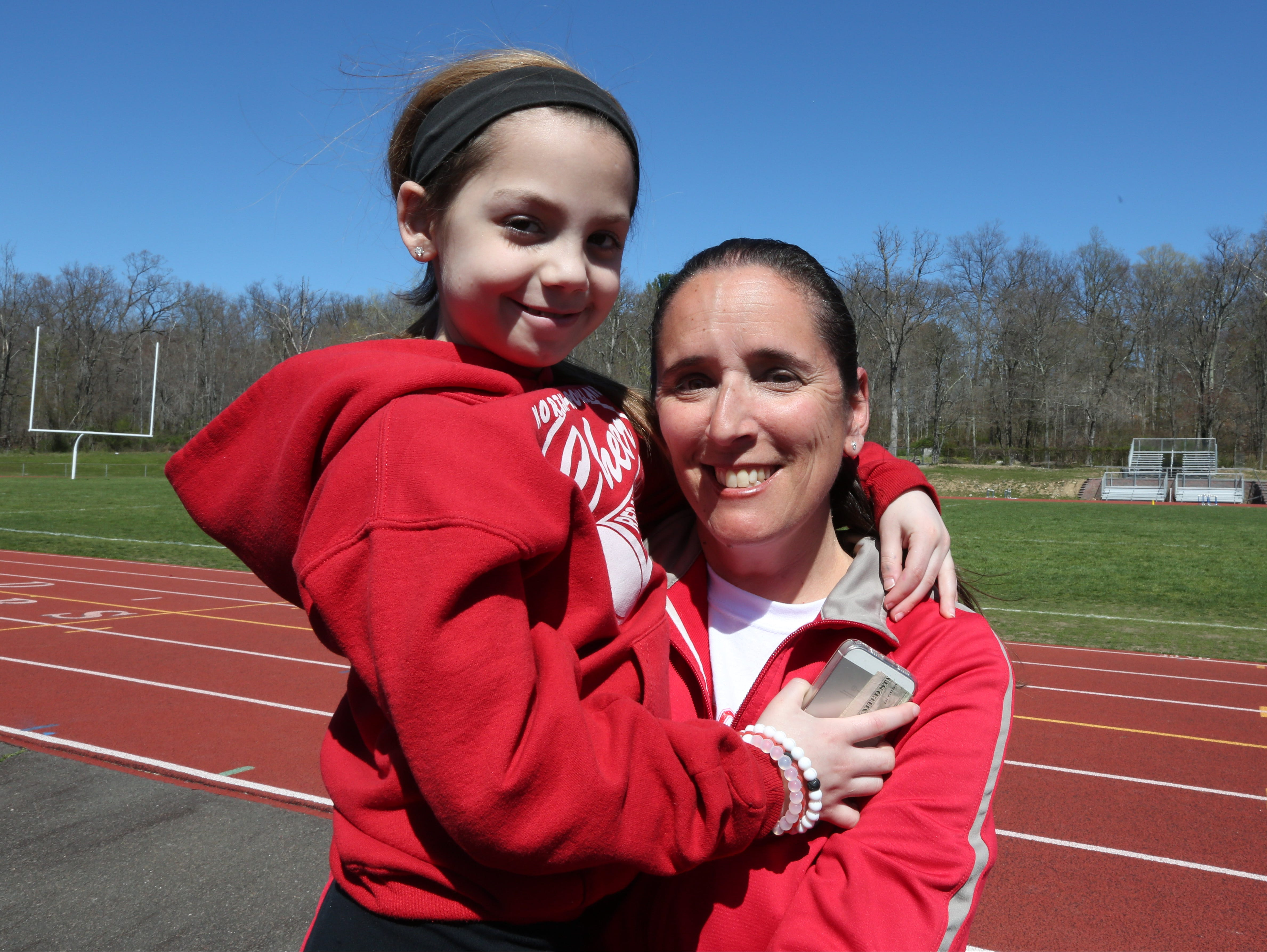 """Stony Point Elementary third-grader Gabby DiCarlo and Jennifer LaBier, Stony Point Elementary teacher and high school tennis coach, at North Rockland High School April 20, 2016. They got together to spread the word about the second annual """"Sports Day"""" at the high school on April 30. So far the program has raised $14,000 for cancer and cystic fibrosis."""