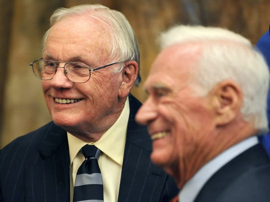 Neil Armstrong and Eugene Cernan, the first and most recent men to walk on the moon, talk prior to a dinner at the Purdue Memorial Union in June 2011.
