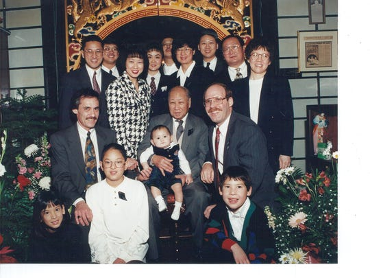 David Leong, center, is surrounded by family.
