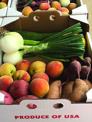 Students and their families in the Newton school district now have the opportunity to receive boxes of fresh fruit and vegetables via a partnership between USD #373 the USDA Farmers to Families program.