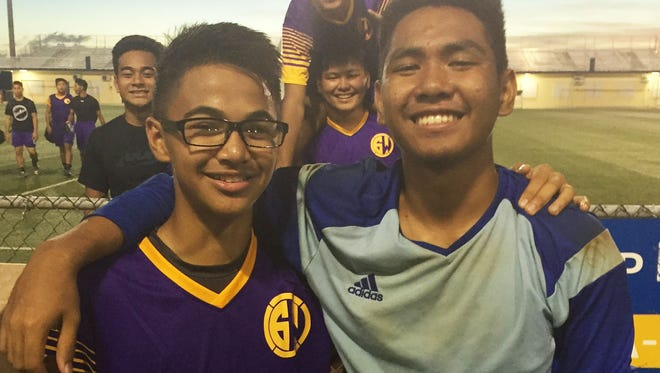 Mason Duenas, left, and Emann Adonay helped lead the GW Geckos to a 5-4 shootout win over the FD Friars in the IIAAG Boys Soccer League playoffs.