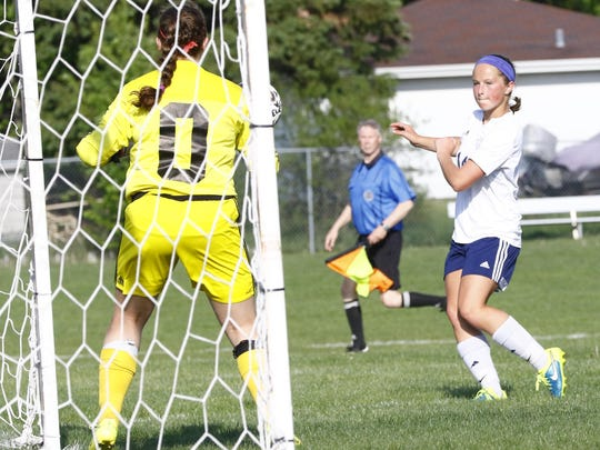 Wausau West's Kayla Durr, right, attempts to score past Wausau East goalie Alexis Pickard during Tuesday's Wisconsin Valley Conference girls soccer game at Wausau West High School soccer field.