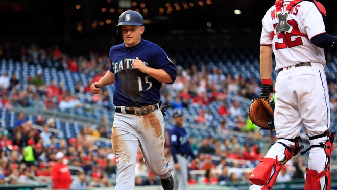 Seattle Mariners third baseman Kyle Seager scores on a single by teammate Robinson Cano during the first inning of Wednesday's baseball game.