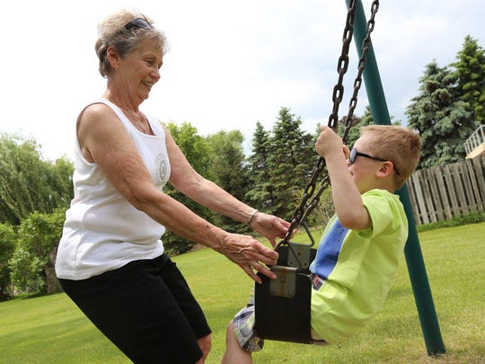 Joyce Esper, 76, of Highland has a life filled with activity and family, including great-grandson Bryson Crammer, 4. She worried forgetfulness was something more. Participating in the study trial, she says, can help people feel less helpless about the possibility of Alzheimer's disease.