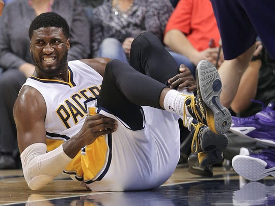Pacers center Roy Hibbert holds his ankle in pain after coming down on it the wrong way during the first half of the game against the Phoenix Suns at Bankers Life Fieldhouse on Saturday, Nov. 22, 2014. Hibbert left the game but came back in late in the second period.