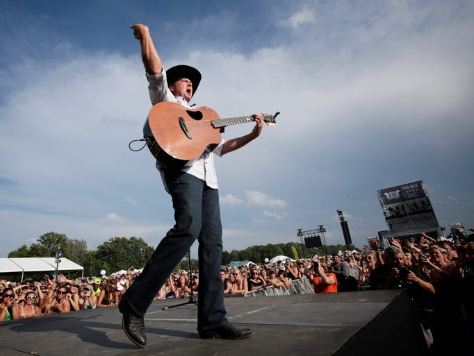 Tracy Lawrence performs to the crowd during the Faster