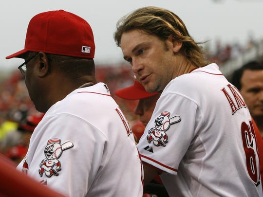** FILE ** In this  June 12, 2008 file photo, Cincinnati Reds pitcher Bronson Arroyo, right, talks with manager Dusty Baker during a baseball game against the St. Louis Cardinals, in Cincinnati. Arroyo has won his last five starts and hopes to remain with the Reds next season. (AP Photo/David Kohl)