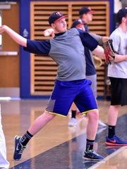 CASHS baseball players go through throwing drills during