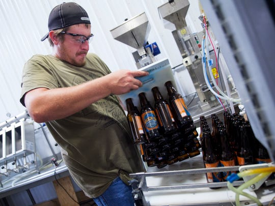 Blue Mountain Brewery beer is packaged at the Blue Mountain Barrel House in Nelson County on August 19, 2014.