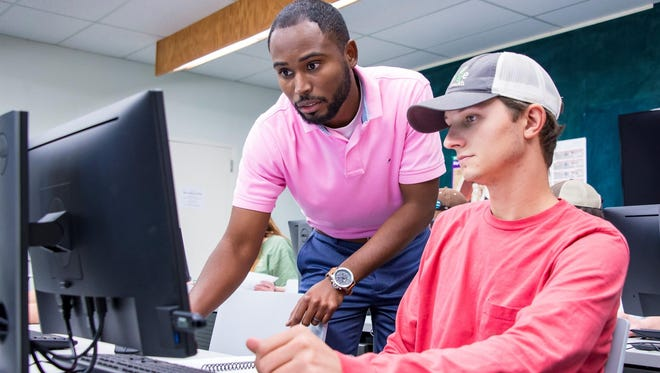 MSU instructor T.J. Bradford, left, works with senior agronomy major John Clay Lyles of Lawrence in the College of Agriculture and Life Sciences' new Precision Agriculture Laboratory in Dorman Hall.