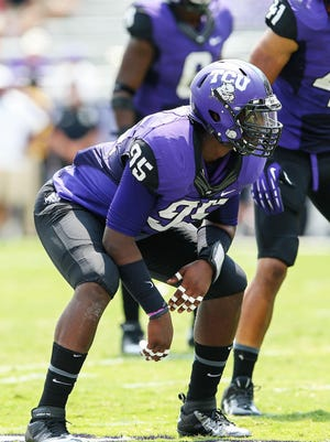 Sep 7, 2013; Fort Worth, TX, USA; TCU Horned Frogs defensive end Devonte Fields (95) plays defense during the game against the Southeastern Louisiana Lions at Amon G. Carter Stadium. Mandatory Credit: Kevin Jairaj-USA TODAY Sports