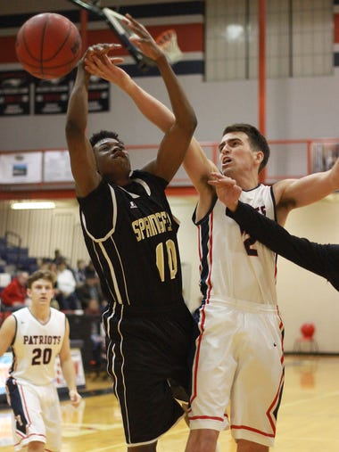 Springfield's Tywan Black distrupts the drive of White