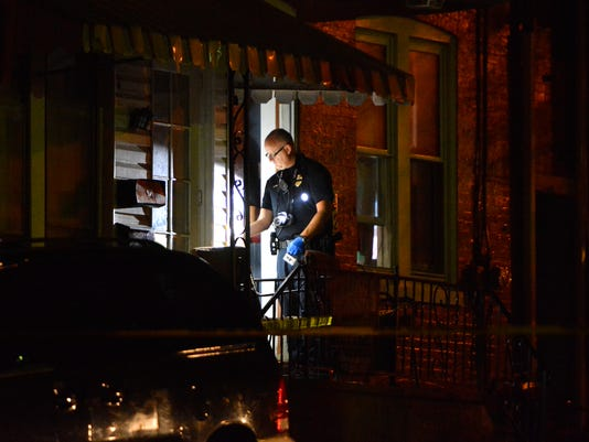 York City Police investigate a reported fatal shooting in the 300 block of East Cottage Place Tuesday September 1, 2015.