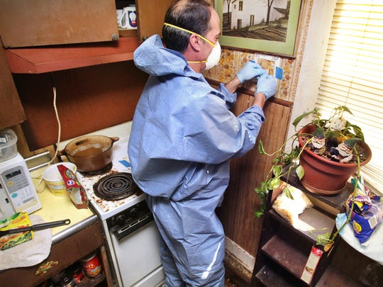 Rick Held of Crisis Cleaning, Bloomfield, swipes the kitchen wall of a rental property in Crawfordsville that was used as a meth lab until the residents were busted by the police in February, 2012. Charlie Nye / The Star