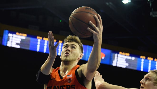 Oregon State Beavers forward Tres Tinkle (3) shoots against UCLA Bruins center Thomas Welsh (40) in the first half at Pauley Pavilion.