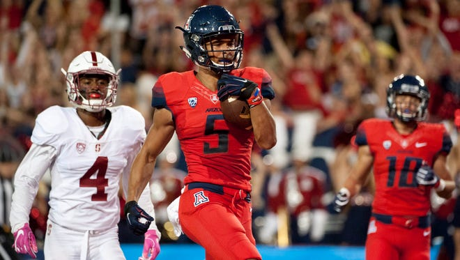 Oct 29, 2016; Tucson, AZ, USA; Arizona Wildcats wide receiver Trey Griffey (5) runs the ball for a touchdown under pressure from Stanford Cardinal cornerback Frank Buncom (4) during the second quarter at Arizona Stadium.
