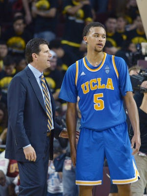 UCLA Bruins coach Steve Alford (left) and guard Kyle Anderson (5) during the game against the Southern California Trojans at Galen Center. UCLA defeated USC 83-73.