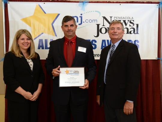 Tate High School's Ronnie Douglas is named Football Coach of the Year on Thursday during the Pensacola News Journal All-Sports Award Banquet sponsored by Troy Rafferty. Pensacola News Journal Publisher Terry Horne and Kim Adams, representing Rafferty, present the award.