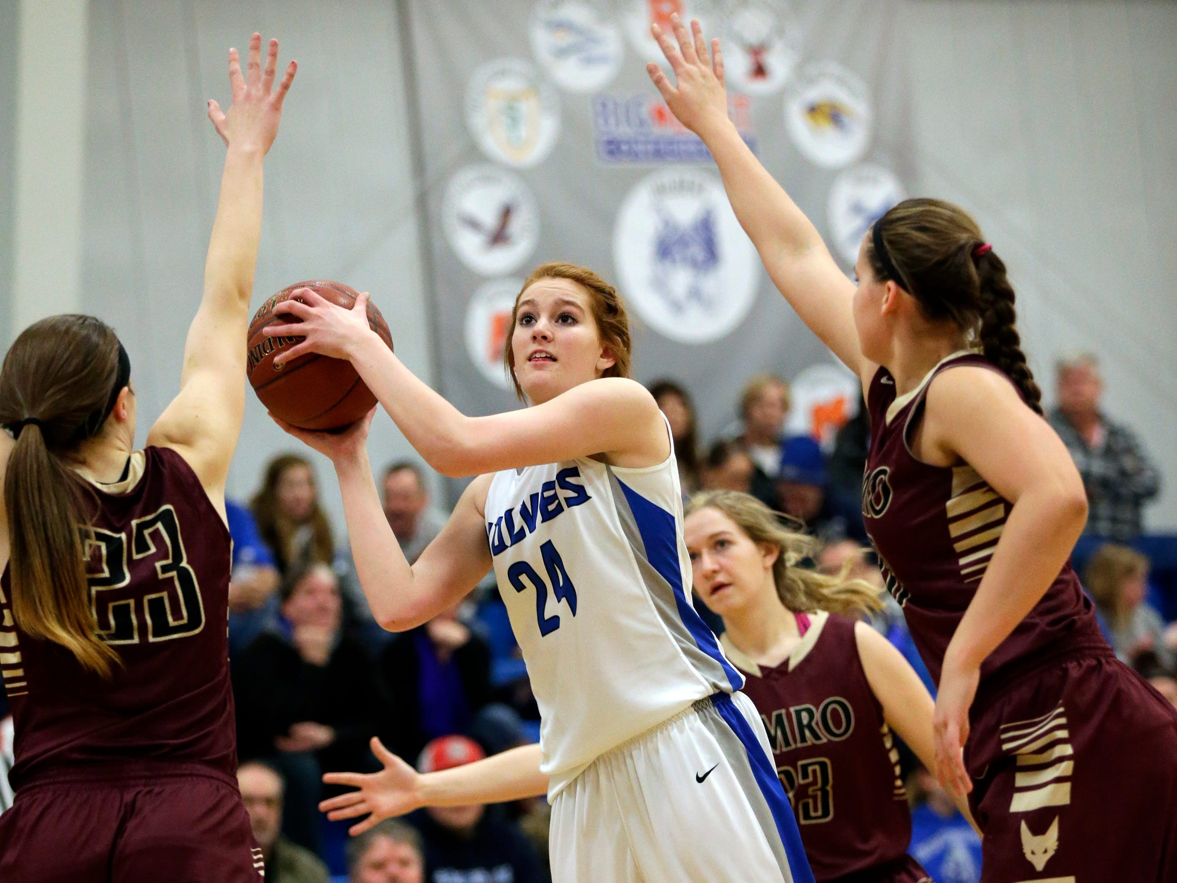 Hilbert High School's April Gehl (24) returned to the court for second half against Omro High School following a 4-1/2 game suspension Monday, January 25, 2016, in Hilbert, Wisconsin.
