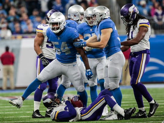 Lions linebacker Steve Longa (54) celebrates after making a tackle on Vikings punt returner Marcus Sherels in the second half at Ford Field, Thursday, Nov. 23, 2017.