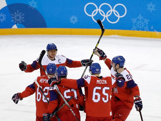 the Czech Republic players celebrate after Michal Repik (62), of the Czech Republic, scores a goal against Switzerland during the first period of the preliminary round of the men's hockey game at the 2018 Winter Olympics in Gangneung, South Korea, Sunday, Feb. 18, 2018. (AP Photo/Matt Slocum)
