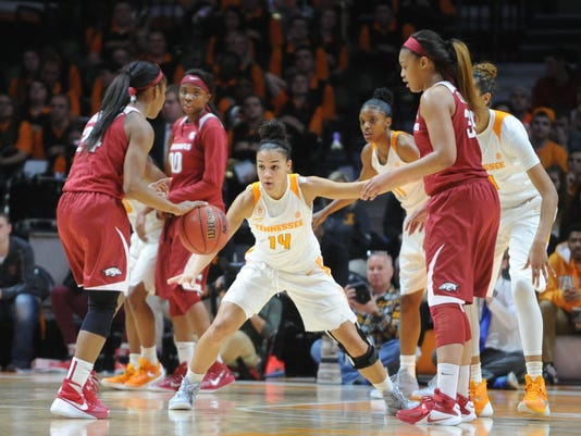 Tennessee guard Andraya Carter (14) defends Arkansas guard Jordan Danberry (24) during the first half of a NCAA college basketball game on Thursday, Feb. 4, 2016, in Knoxville, Tenn. Tennessee defeated Arkansas 75-57. (Caitie McMekin/Knoxville News Sentinel via AP) MANDATORY CREDIT
