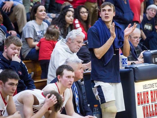 Blue River's Trey Klein encourages his teammates on