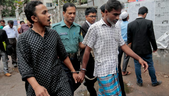 Men are escorted by police in Dhaka, Bangladesh, on June 13, 2016, as part of a nationwide crackdown on a wave of brutal attacks on religious minorities.